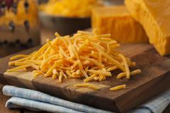 organic shredded sharp cheddar cheese - stock photo