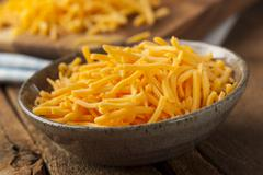 Organic shredded sharp cheddar cheese Stock Photos