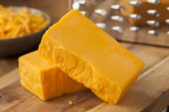 organic sharp cheddar cheese - stock photo