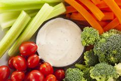 organic raw vegetables with ranch dip - stock photo