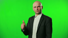 Portrait of handsome businessman with thumb up against a green screen HD Stock Footage