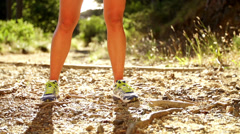 Woman drinking cool water after a run in slow motion - stock footage