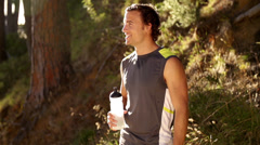 Man drinking cool water after a run in slow motion Stock Footage