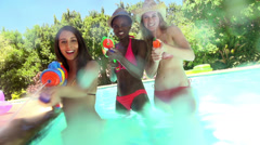 Friends playing with squirt gun Stock Footage