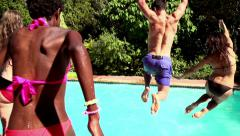Friends jumping into a pool Stock Footage