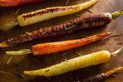 Colorful multi colored roasted carrots Stock Photos