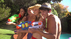 Friends shooting squirt gun Stock Footage