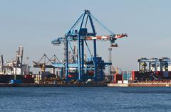 Port with cranes and containers Stock Photos