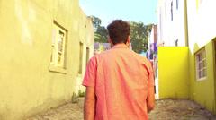 Man walking in alley in slow motion Stock Footage
