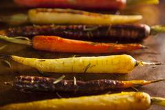 colorful multi colored roasted carrots - stock photo