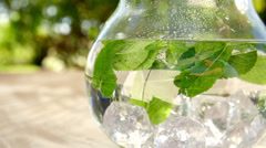 Jug of water with fresh mint leaves;Slow Motion - stock footage