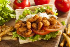 homemade shrimp po boy sandwich - stock photo