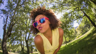 Stock Video Footage of Afro Girl with sunglasses in park