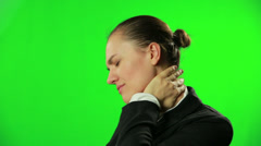 Businesswoman with neck pain against a green screen HD Stock Footage