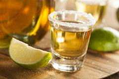 Tequila shots with lime and salt Stock Photos