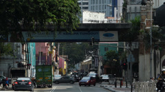 Time Lapse Kuala Lumpur Traffic and Metro Train passing on elevated Rail Stock Footage