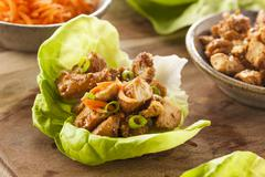 Stock Photo of healthy asian chicken lettuce wrap