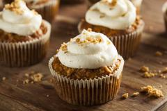 homemade carrot cupcakes with cream cheese frosting - stock photo
