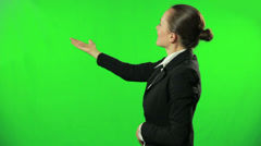 Female weathercaster giving weather report against a green screen HD Stock Footage