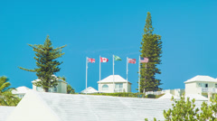 Hotel Building with Flags in St. George's, Bermuda - stock footage