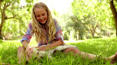 Stock Video Footage of Girl is playing with her puppy