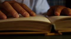 Hand over book while reading. Close Up. Stock Footage