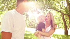 Loving family in park with child Stock Footage