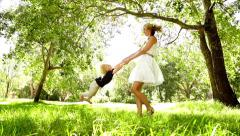Mother spinning son around - stock footage