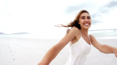 Couple is spinning around at the beach Stock Footage