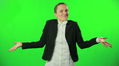 Businesswoman shrugging against a green background HD - stock footage