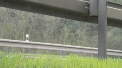 a crash barrier and roadside with going truck - stock footage