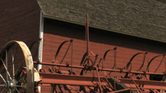 Red barn and farm implement - stock footage