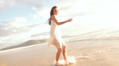 Girl is splashing water at the beach Stock Footage