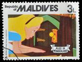 Stock Photo of maldives postage stamp shows alice in wonderland