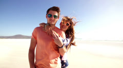 Loving couple on beach - stock footage