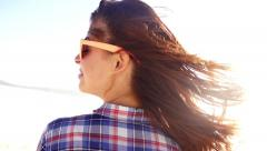 Girl at the beach wind in hair Stock Footage
