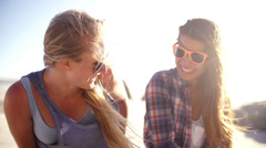 Best friends laughing on beach Stock Footage