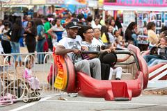 Family rides scrambler carnival ride at atlanta fair Stock Photos