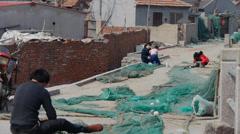 Fishermen repair nets. Stock Footage
