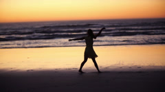 Girl is walking along the beach at night Stock Footage