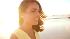 Smiling girl walking on sunny day on beach Stock Footage