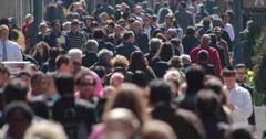 Crowd of commuter people walking on city street sidewalk 4k timelapse Stock Footage