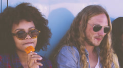 Hipster eating popsicles Stock Footage