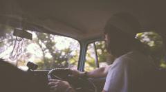 Man driving vintage car Stock Footage