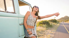 Girl is hitchhiking Stock Footage