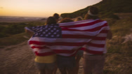 Stock Video Footage of Friends wrapped in stars and stripes