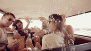 Stock Video Footage of Hipsters blowing bubbles in camper van