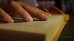 Hand over book while reading. Close Up. - stock footage