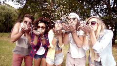 Hipsters blowing confetti - stock footage