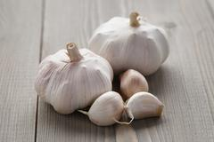 Stock Photo of garlic on wood table